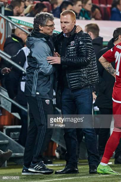 Cocoach Ovid Hajou of Ingolstadt shakes hands with Head coach Maik Walpurgis of Ingolstadt during the Bundesliga match between FC Augsburg and FC...