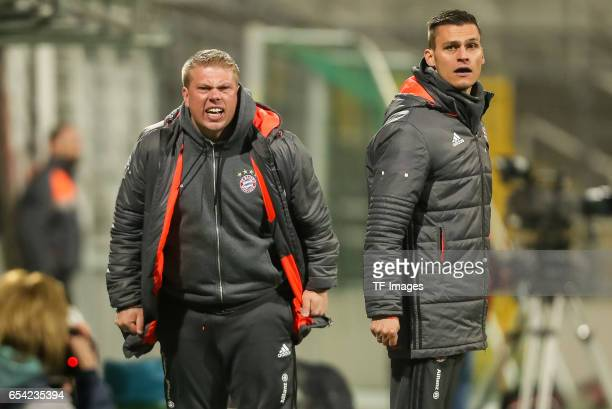 cocoach Roman Langer of Bayern Muenchen gestures Head coach Thomas Woerle of Bayern Muenchen looks on during the Women's DFB Cup Quarter Final match...