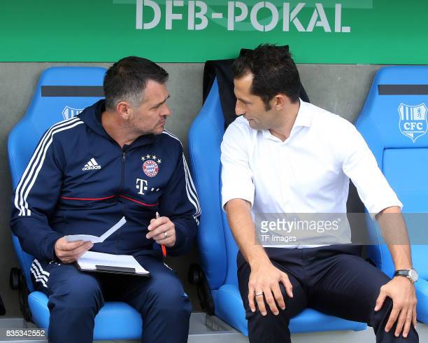 Cocoach Willy Sagnol of Bayern Muenchen speak with Hasan Salihamidzic of FC Bayern Muenchen l during the DFB Cup first round match between Chemnitzer...