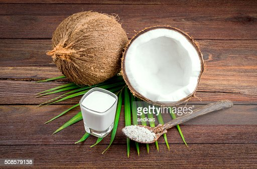 Coconut and coconut milk in glass : Bildbanksbilder