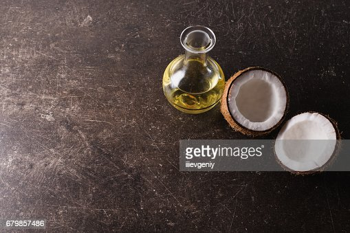 Coconut And Coconut Oil On A Dark Marble Background Exotic