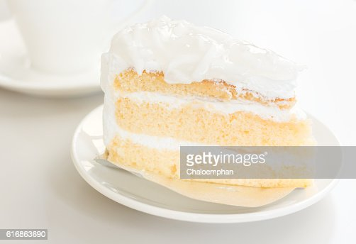 Coconut cake in white plate with coffee cup : Stock Photo