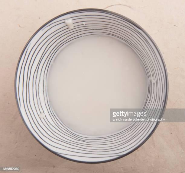 Coconut cream in striped bowl.