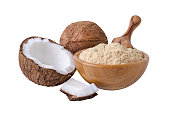 coconut flour in wooden bowl isolated on white background