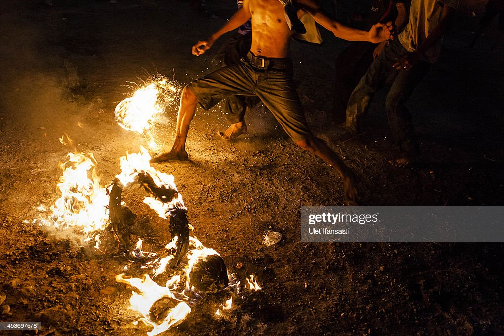 A coconut is soaked in kerosene and set on fire for 'fire football' during celebrations of Indonesia's National Independence Day on August 16, 2014 in Yogyakarta, Indonesia. Indonesia became an independent nation on August 17, 1945 having previously been under Dutch rule.
