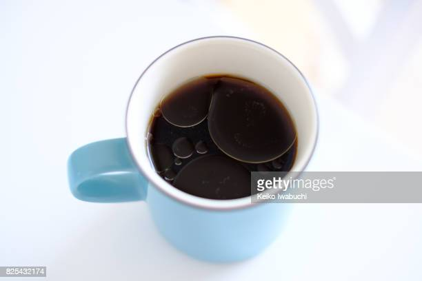 Coconut oil on the surface of black coffee