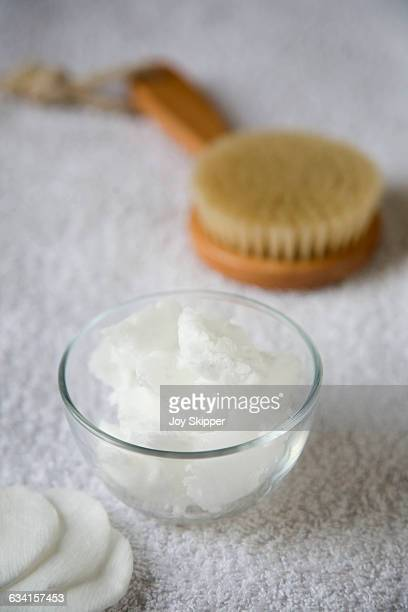 Coconut oil with body brush