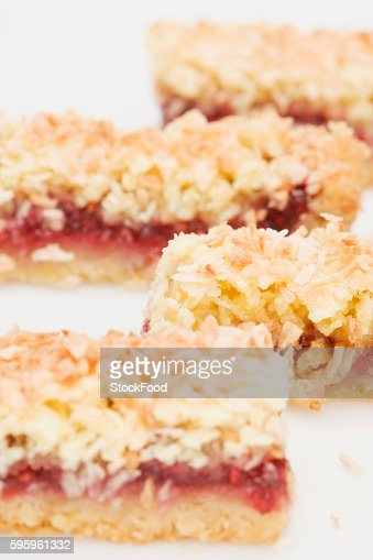 Coconut slices with raspberry jam filling