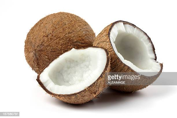 Coconuts with one cracked open exposing the white meat