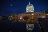 Cocooned in scaffolding the US Capitol dome is seen in a reflecting pool on October 28 2014 in Washington DC as it undergoes its first comprehensive...