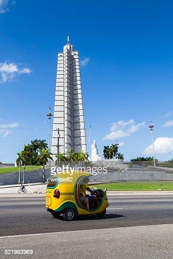 Cocotaxi passes the Jose Marti memorial