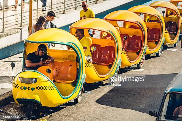 Coco-taxis in Havana waiting for clients