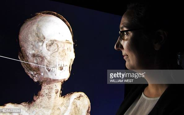 CoCurator Marie Vandenbeusch looks at a threedimensional image of a CT scan of an Egyptian mummy as the the hidden secrets of Egyptian mummies up to...