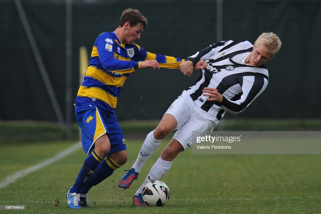 Cocuzza (L) of FC Parma competes with Magnusson of Juventus FC during the Juvenile match between Juventus FC and FC Parma at Juventus Center Vinovo on November 21, 2012 in Vinovo, Italy.