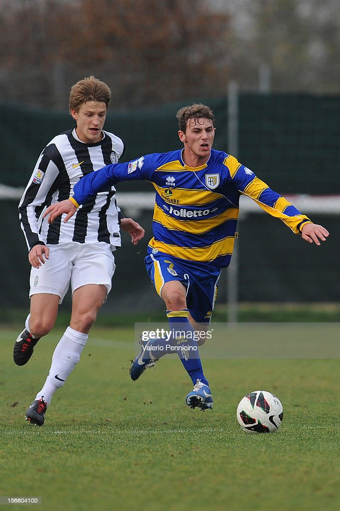 Cocuzza (R) of FC Parma in action during the Juvenile match between Juventus FC and FC Parma at Juventus Center Vinovo on November 21, 2012 in Vinovo, Italy.