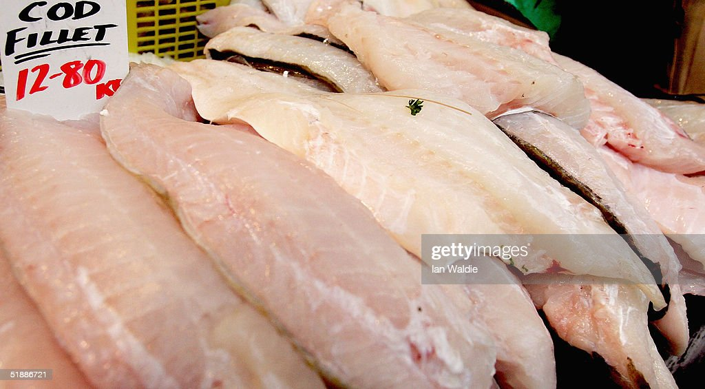 Cod fillets are displayed at a fishmongers stall at Borough Market on December 22 2004 in London England The European Union has agreed new fishing...