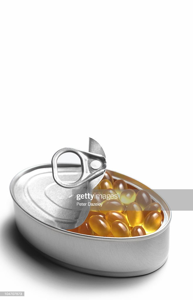 Cod liver oil capsules in tin : Stock Photo