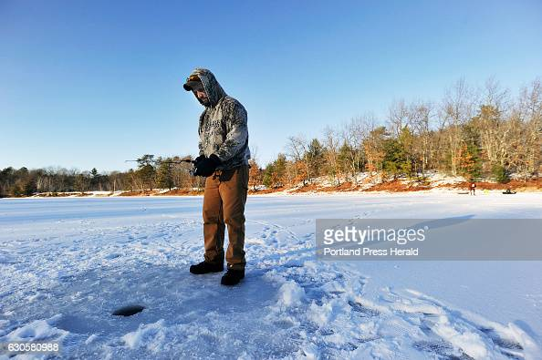 Ice ponds stock photos and pictures getty images for Otter ice fishing