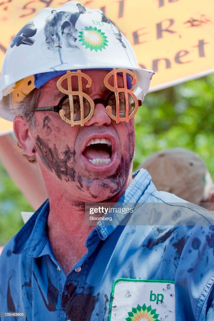 A Code Pink activist dressed as an oil roughneck takes part in a demonstration outside the U.S. headquarters of BP Plc in Houston, Texas, U.S., on Monday, May 24, 2010. BP Plc will try in two days to plug an oil leak off Louisiana's coast by pumping heavy drilling fluids into the Macondo well, which was damaged when the Deepwater Horizon drilling rig exploded on April 20. BP said it's committing as much as $500 million on a research program studying the impact of the incident on the marine and shoreline environment of the Gulf of Mexico. Photographer: F. Carter Smith/Bloomberg via Getty Images