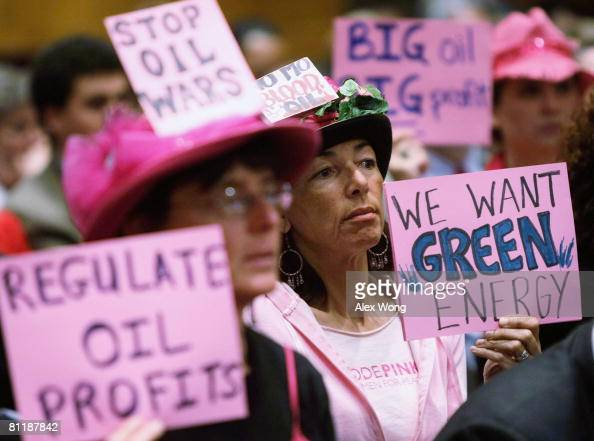 Code Pink members Desiree Farooz and Toby Blome protests during a hearing of the Senate Judiciary Committee May 21 2008 on Capitol Hill in Washington...