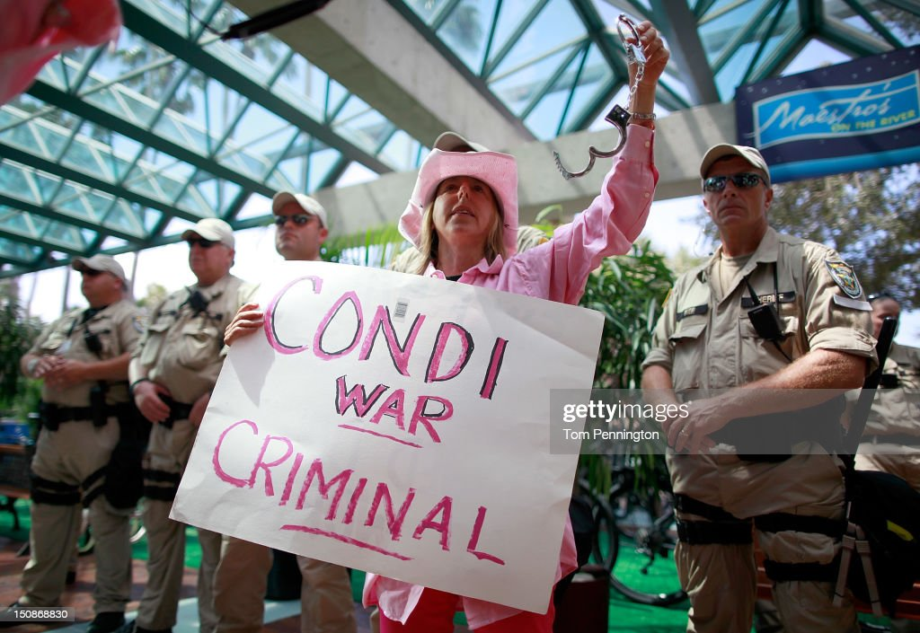 Code Pink protester Medea Benjamin (2nd R) demonstrates in front of the Stratz Center for the Performing Arts on August 28, 2012 in Tampa, Florida. The Code Pink protesters were on hand to perform a citizen's arrest on Former Secretary of State Condoleezza Rice for her involvement in the U.S. lead wars in Afghanistan and Iraq.