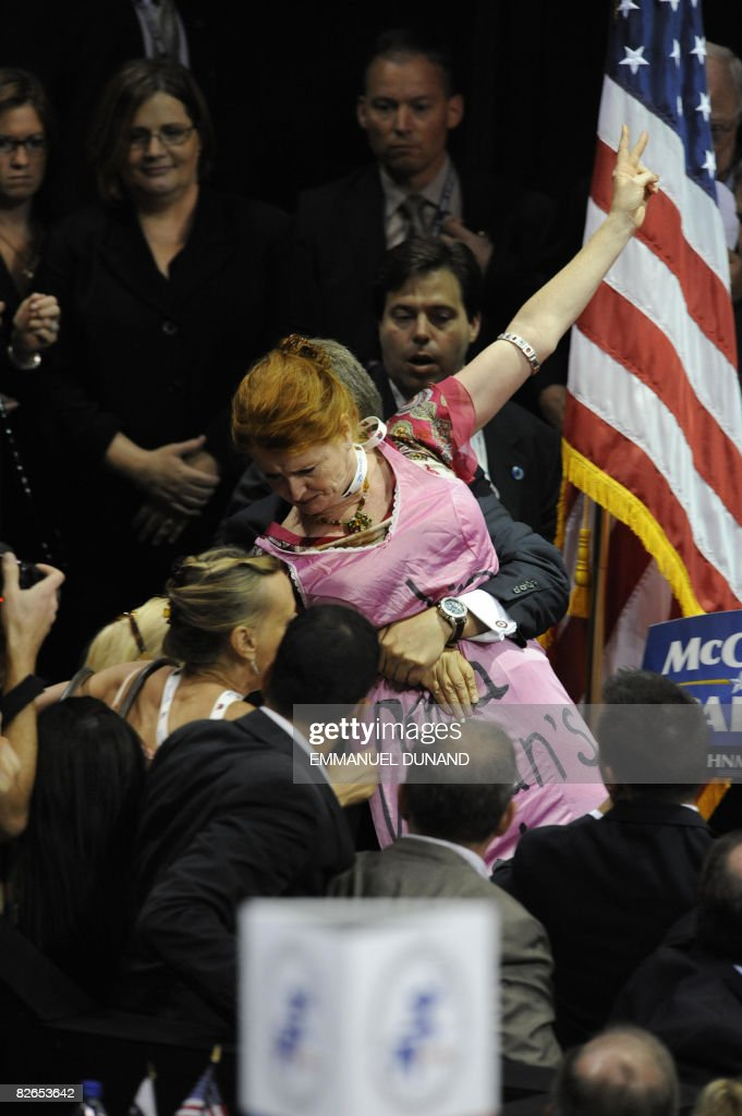A Code Pink supporter is grabbed by security and escorted out during the acceptance speech of Sarah Palin vice presidential nominee at the Republican...