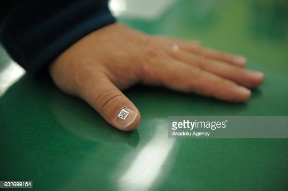 QR code stuck onto a nail of a man is seen in Iruma city Saitama Prefecture in western of Tokyo Japan on January 25 2017 Since the end of the 2016...