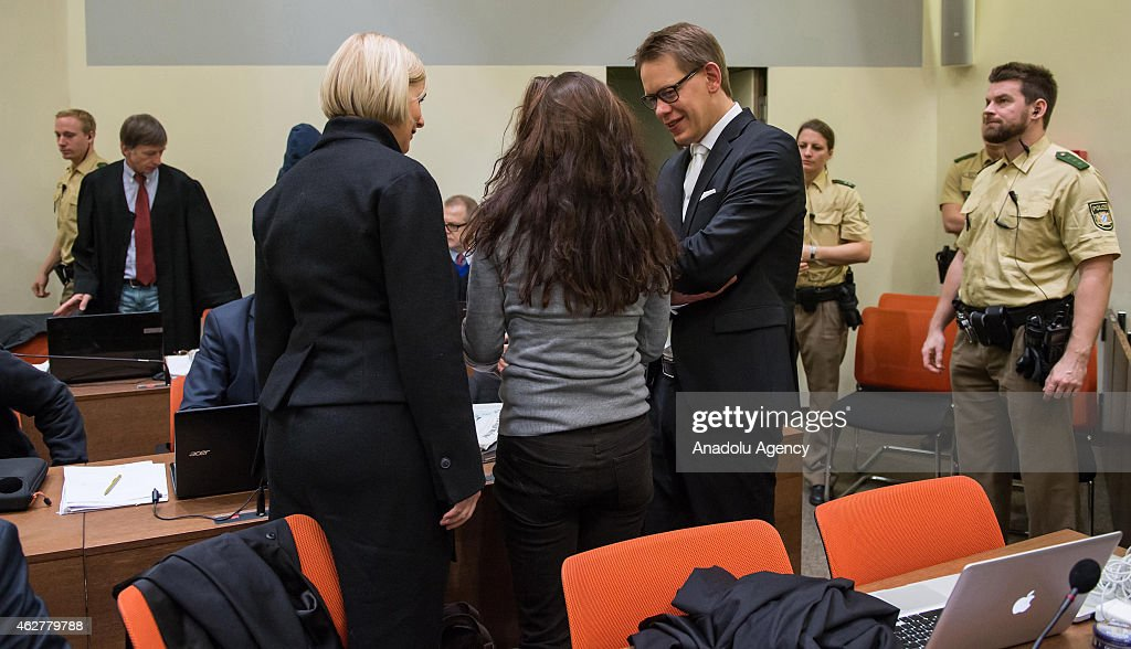 Co-defendant <a gi-track='captionPersonalityLinkClicked' href=/galleries/search?phrase=Beate+Zschaepe&family=editorial&specificpeople=8630982 ng-click='$event.stopPropagation()'>Beate Zschaepe</a> (C) and her lawyers <a gi-track='captionPersonalityLinkClicked' href=/galleries/search?phrase=Wolfgang+Heer+-+Lawyer&family=editorial&specificpeople=14887066 ng-click='$event.stopPropagation()'>Wolfgang Heer</a> (R) and <a gi-track='captionPersonalityLinkClicked' href=/galleries/search?phrase=Anja+Sturm&family=editorial&specificpeople=10879931 ng-click='$event.stopPropagation()'>Anja Sturm</a> (L) wait for the start of 183rd day of the NSU neo-Nazi murders trial in Oberlandesgericht (Higher Regional Court) in Munich on February 5, 2015. Zschaepe is the chief defendant among five people accused of assisting the dead NSU-members Uwe Mundlos and Uwe Boehnhardt in their eight-year murder spree that targeted nine immigrants and one policewoman.
