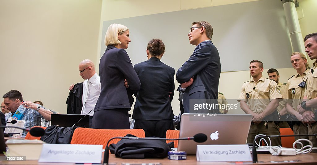 Co-defendant <a gi-track='captionPersonalityLinkClicked' href=/galleries/search?phrase=Beate+Zschaepe&family=editorial&specificpeople=8630982 ng-click='$event.stopPropagation()'>Beate Zschaepe</a> (C) and her lawyers <a gi-track='captionPersonalityLinkClicked' href=/galleries/search?phrase=Wolfgang+Heer+-+Lawyer&family=editorial&specificpeople=14887066 ng-click='$event.stopPropagation()'>Wolfgang Heer</a> (R) and <a gi-track='captionPersonalityLinkClicked' href=/galleries/search?phrase=Anja+Sturm&family=editorial&specificpeople=10879931 ng-click='$event.stopPropagation()'>Anja Sturm</a> (L) wait for the beginning of another day of the NSU neo-Nazi murders trial on June 30, 2015 in Munich, Germany. Zschaepe is the chief defendant among five people accused of assisting Mundlos and Boehnhardt in their eight-year murder spree that targeted nine immigrants and one policewoman.
