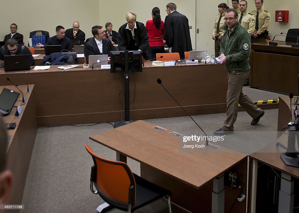 Co-defendant Beate Zschaepe waits for the beginning of today's NSU neo-Nazi murders trial, in which Zschaepe's mother and other witnesses will testify in the witness stand (front) on November 27, 2013 in Munich, Germany. Zschaepe is accused of assisting neo-Nazis Uwe Mundlos and Uwe Boehnhardt in their eight-year murder spree that targeted nine immigrants and one policewoman.