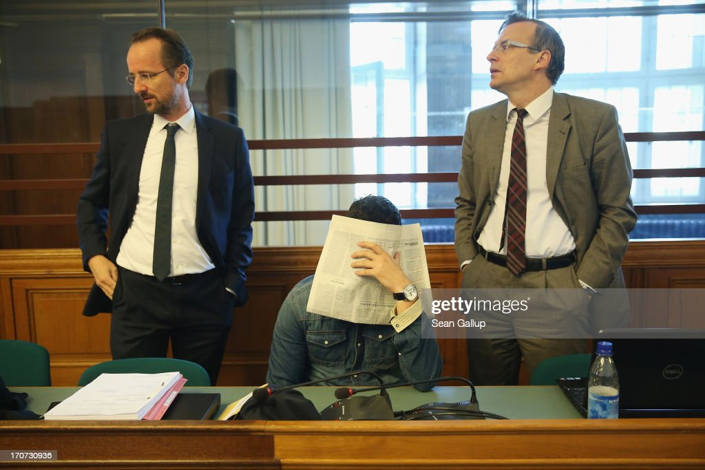 A co-defendant covers his face shortly before the continuation of the trial of the six Jonny K. attackers at the Kriminalgericht Moabit court on June 17, 2013 in Berlin, Germany. The six young men are accused of assaulting Jonny K. in front of a bar on Alexanderplatz on October 14, 2012, and beating him so severely that Jonny K. later died of his head injuries. His sister Tina has led a media campaign to draw publicity to the case and the issue of violence in German society.