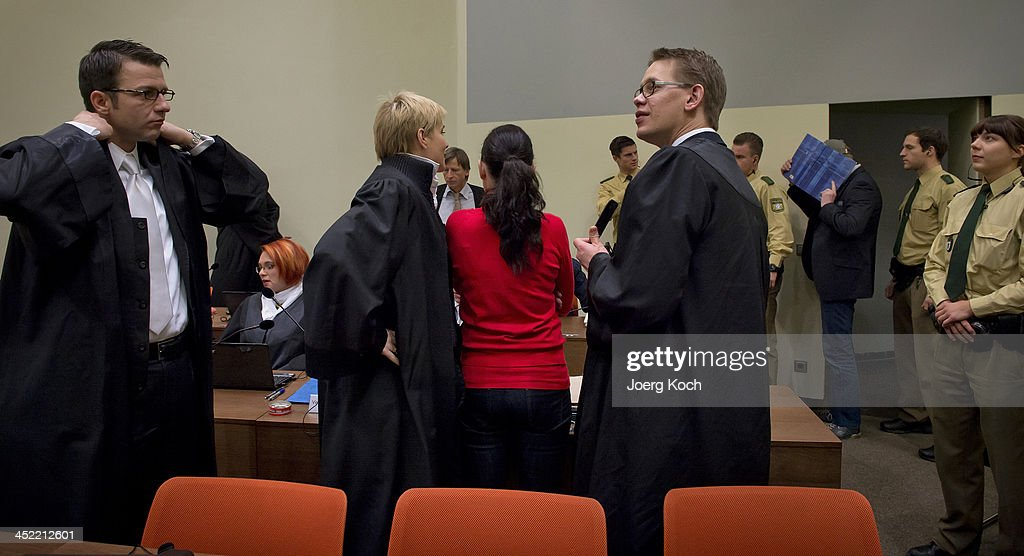 Co-defendants Beate Zschaepe (C) and Holger G. (3rd-R) arrive for today's NSU neo-Nazi murders trial, in which Zschaepe's mother and other witnesses will testify today on November 27, 2013 in Munich, Germany. Zschaepe and the others are accused of assisting neo-Nazis Uwe Mundlos and Uwe Boehnhardt in their eight-year murder spree that targeted nine immigrants and one policewoman.