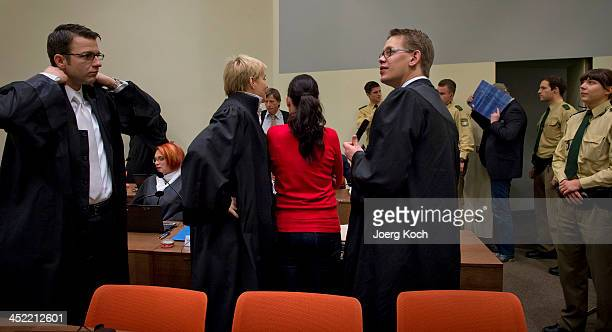 Codefendants Beate Zschaepe and Holger G arrive for today's NSU neoNazi murders trial in which Zschaepe's mother and other witnesses will testify...