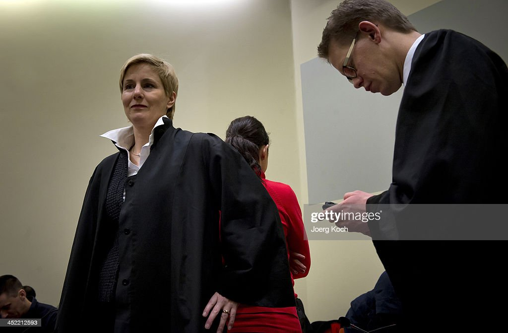 Co-defendants Ralf Wohlleben and her lawyers wait for today's NSU neo-Nazi murders trial, in which Zschaepe's mother and other witnesses will testify today on November 27, 2013 in Munich, Germany. Zschaepe and the others are accused of assisting neo-Nazis Uwe Mundlos and Uwe Boehnhardt in their eight-year murder spree that targeted nine immigrants and one policewoman.