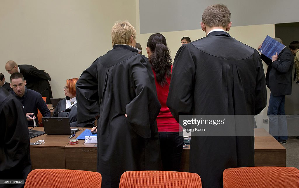 Co-defendants Ralf Wohlleben (L-R), <a gi-track='captionPersonalityLinkClicked' href=/galleries/search?phrase=Beate+Zschaepe&family=editorial&specificpeople=8630982 ng-click='$event.stopPropagation()'>Beate Zschaepe</a> and Holger G. arrive for today's NSU neo-Nazi murders trial, in which Zschaepe's mother and other witnesses will testify today on November 27, 2013 in Munich, Germany. Zschaepe and the others are accused of assisting neo-Nazis Uwe Mundlos and Uwe Boehnhardt in their eight-year murder spree that targeted nine immigrants and one policewoman.