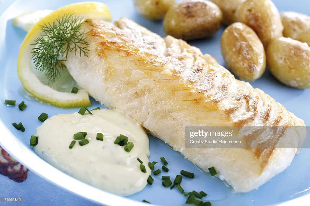 Codfish and remolade with roast potatoes, close-up