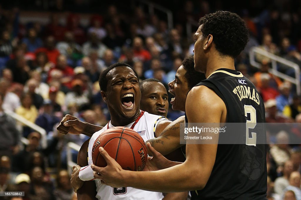 Codi Miller-McIntyre #0 of the Wake Forest Demon Deacons reacts as Devin Thomas #2 of the Wake Forest Demon Deacons looks on in the second half during the first round of the Men's ACC Basketball Tournament at Greensboro Coliseum on March 14, 2013 in Greensboro, North Carolina.