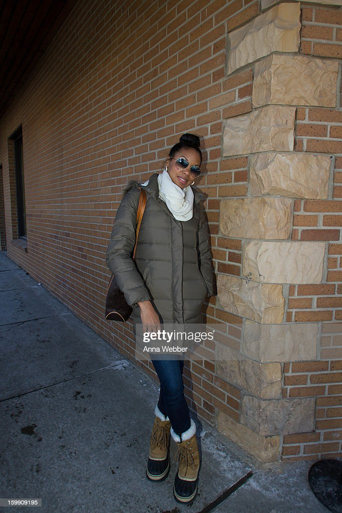 Codie Elaine Brooks, Event Producer for Film Independant from Los Angeles, wearing Ray Ban aviator sunglasses, Streets of NY scarf, North Face jacket, Nordstrom jeans, Sorel boots, and Louis Vuitton bag on January 22, 2013 in Park City, Utah.
