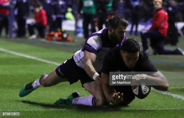 Codie Taylor of New Zealand scores the opening try during the International test match between Scotland and New Zealand at Murrayfield Stadium on...