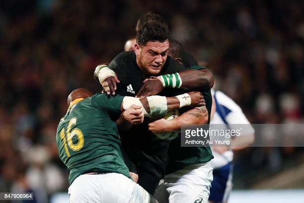 Codie Taylor of the All Blacks is tackled during the Rugby Championship match between the New Zealand All Blacks and the South African Springboks at...