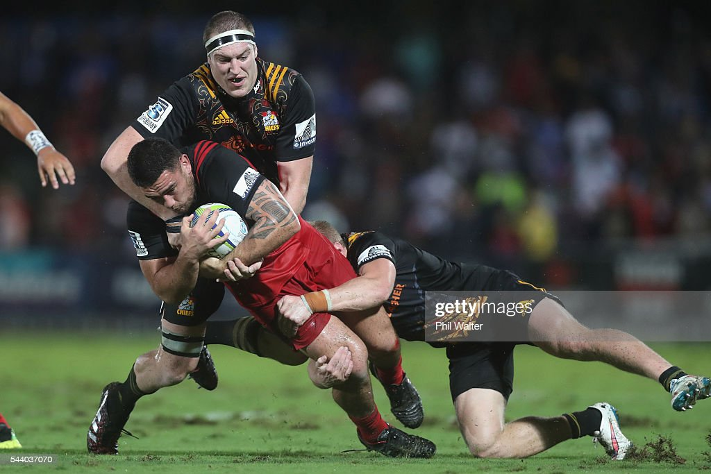 Codie Taylor of the Crusaders is tackeld by <a gi-track='captionPersonalityLinkClicked' href=/galleries/search?phrase=Brodie+Retallick&family=editorial&specificpeople=7864021 ng-click='$event.stopPropagation()'>Brodie Retallick</a> of the Chiefs during the round 15 Super Rugby match between the Chiefs and the Crusaders at ANZ Stadium on July 1, 2016 in Suva, Fiji.