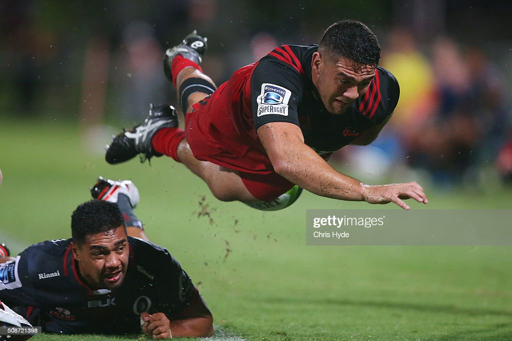 Codie Taylor of the Crusaders is tackled during the Super Rugby preseason match between the Reds and the Crusaders at Ballymore Stadium on February 6...