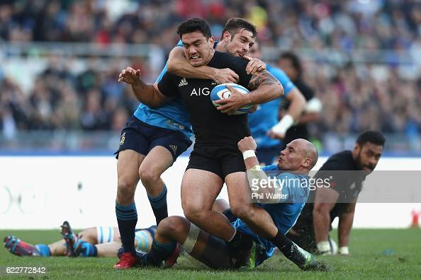 Codie Taylor of the New Zealand All Blacks is tackled during the international rugby match between New Zealand and Italy at Stadio Olimpico on...