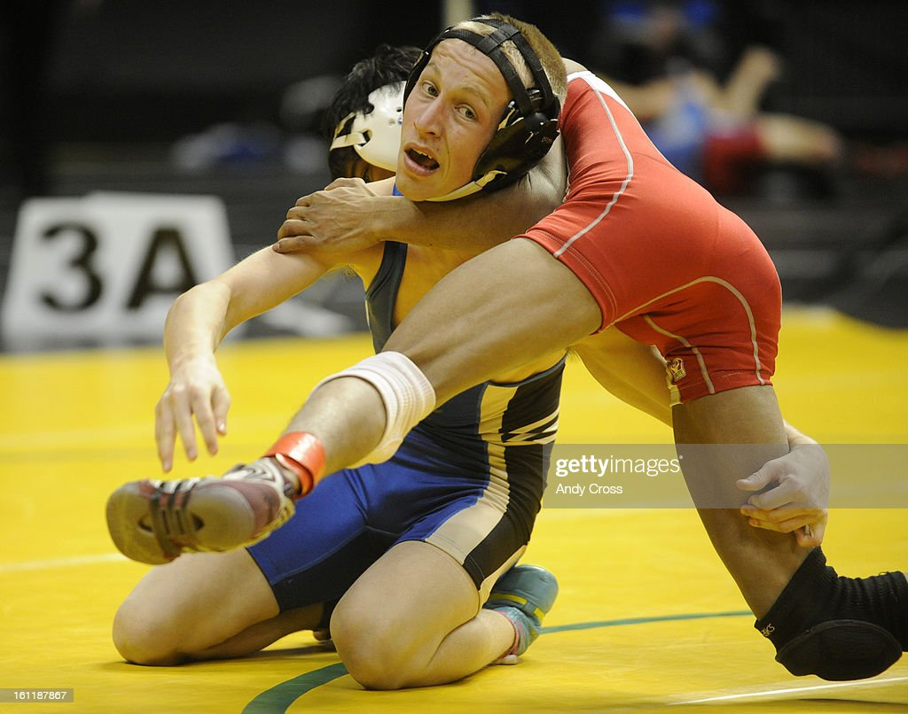 DENVER CODillon Bellino left Florence High School wrestles Vikash Hypio Hotchkis High School during a 3A 103lb division quarter final match during...