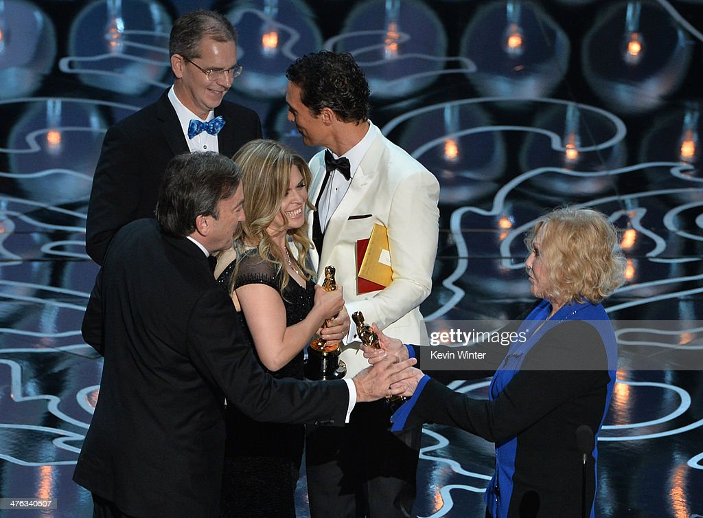 Codirector Chris Buck producer Peter Del Vecho and codirector Jennifer Lee and accept the Best Animated Feature Film award for 'Frozen' from actors...
