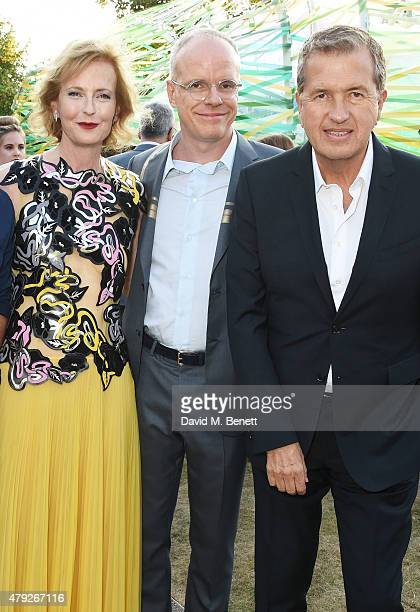 CoDirector of the Serpentine Gallery Julia PeytonJones and HansUlrich Obrist pose with Mario Testino at The Serpentine Gallery summer party at The...