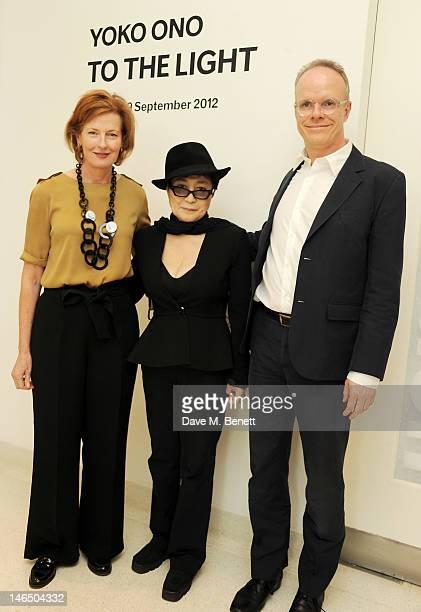 CoDirector of the Serpentine Gallery Julia PeytonJones Yoko Ono and codirector Hans Ulrich Obrist poses during a photocall launching Yoko Ono's...