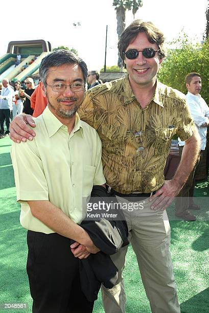 Codirectors John Eng and Norton Virgien pose at the afterparty for 'Rugrats Go Wild' at the Cinerama Dome on June 1 2003 in Los Angeles California