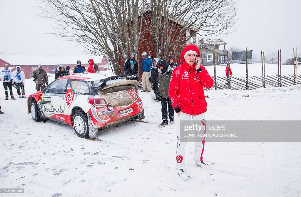 Codriver Paul Nagle of Ireland speaks on the phone after he and his driver Kris Meeke of Britain pulled over their Citroen DS3 WRC due to a problem...