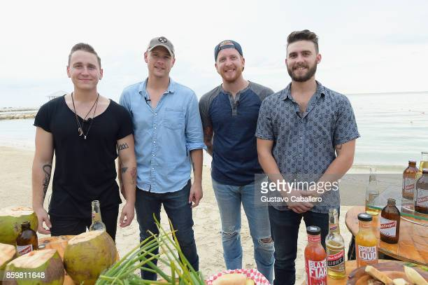 Cody Alan and James Barker Band enjoy local jerk chicken cuisine from Sandalsâ Jerk Shack during Story Behind The Songs LIV Concert Event At Sandals...